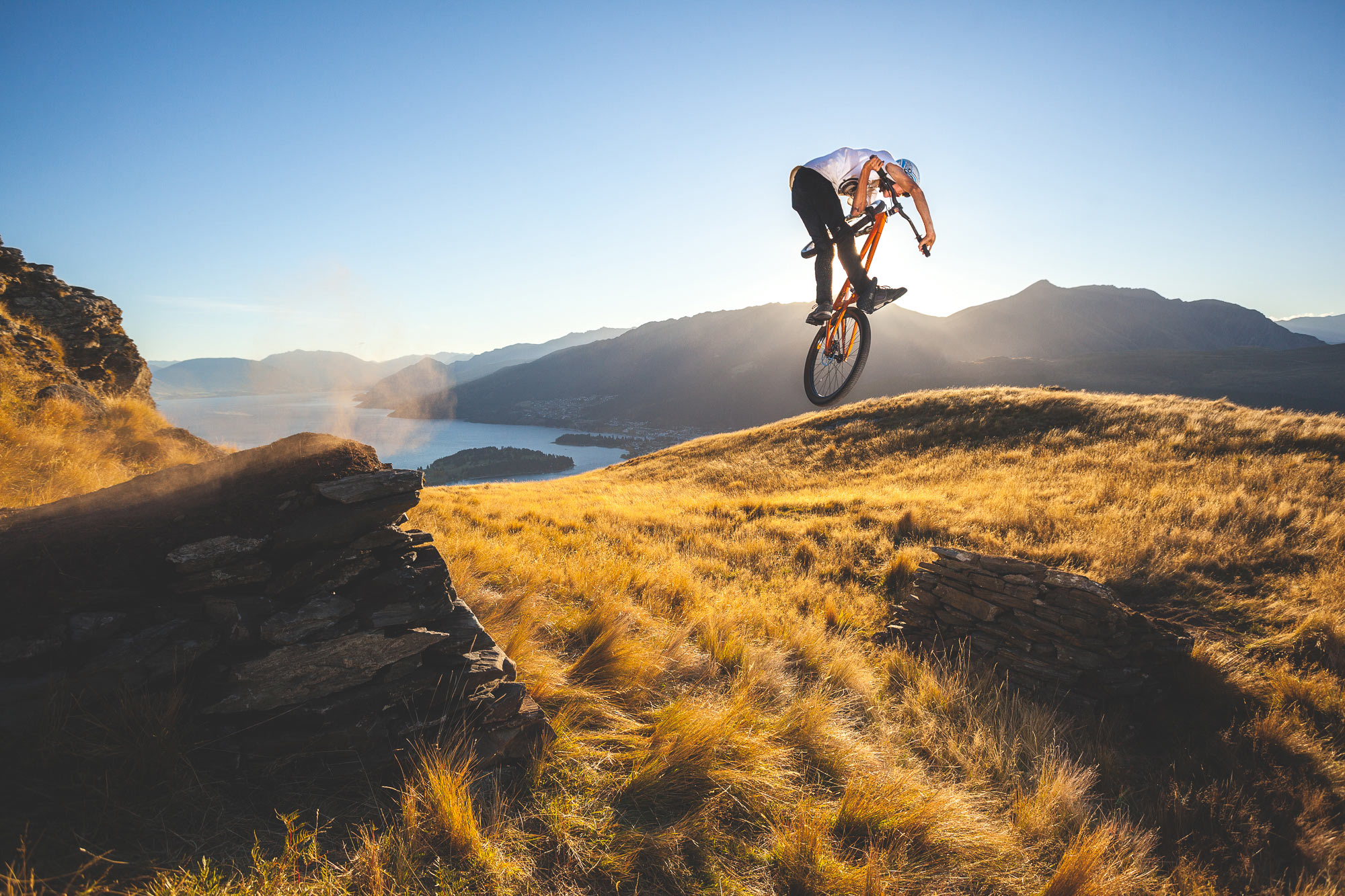 Mountain Bike rider Lewis Jones jumps above queenstown