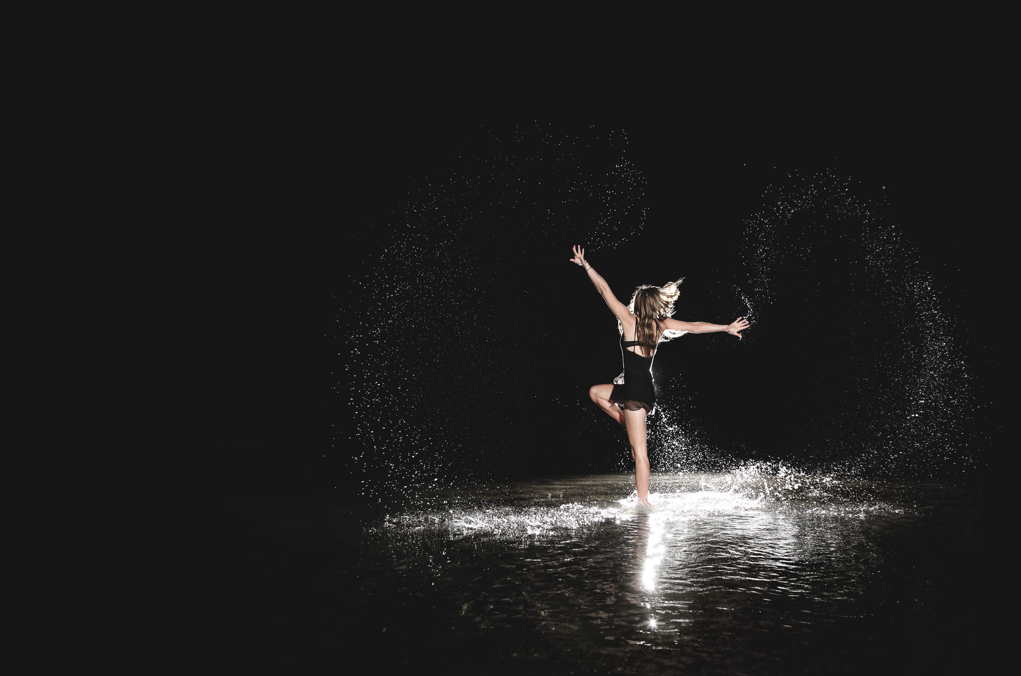 Ballet Dancer dancing in a lake in the rain