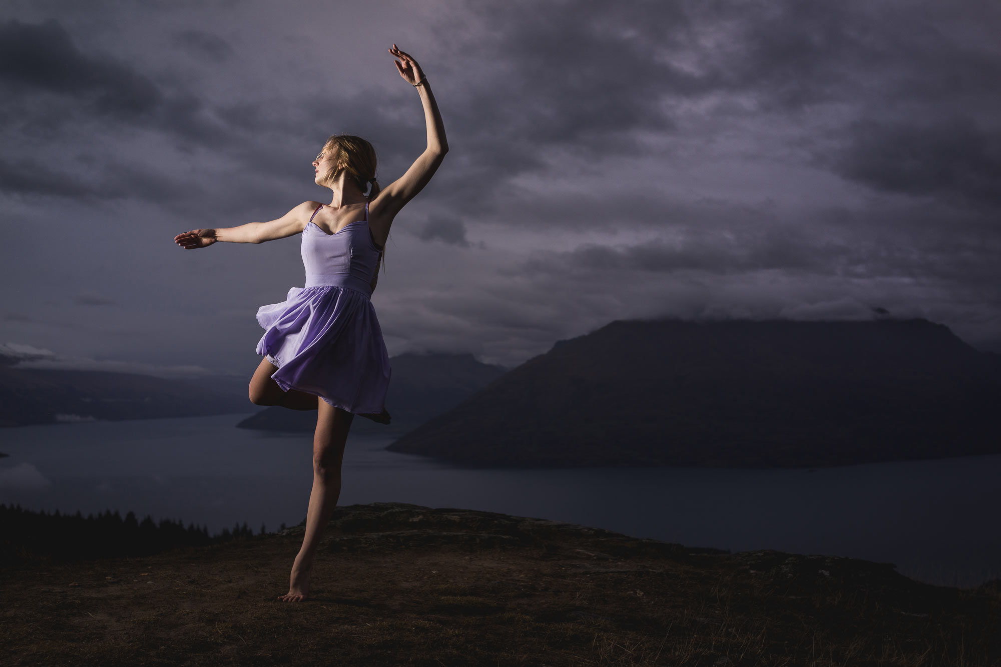 Ballet dancer dancing in a storm ontop of the mountains in Queenstown