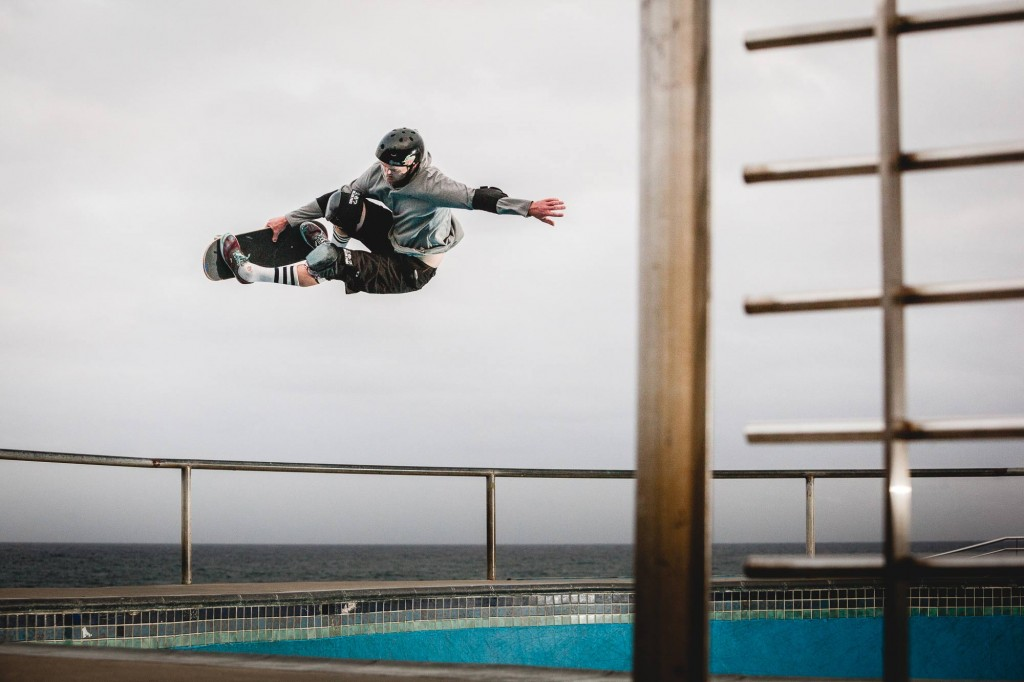 Bowl Skater jumping out of Bondi Bowl in Sydney