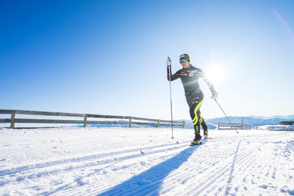 Cross country Skier Anouk Faivre Picon going around the New Zealand snow farm track in Cardrona valley