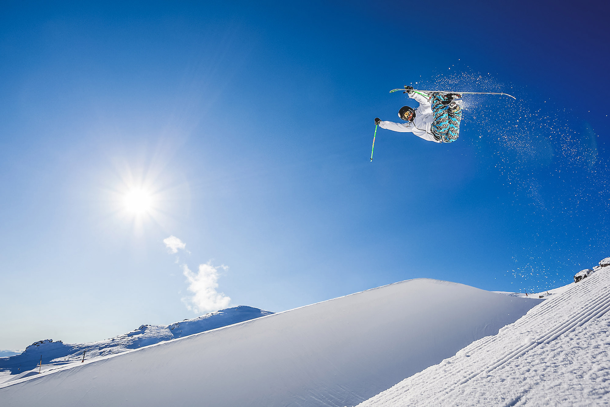 Freestyle skier Kentaro Tsuda jumping out of the halfpipe at Cardrona alpine ski resort