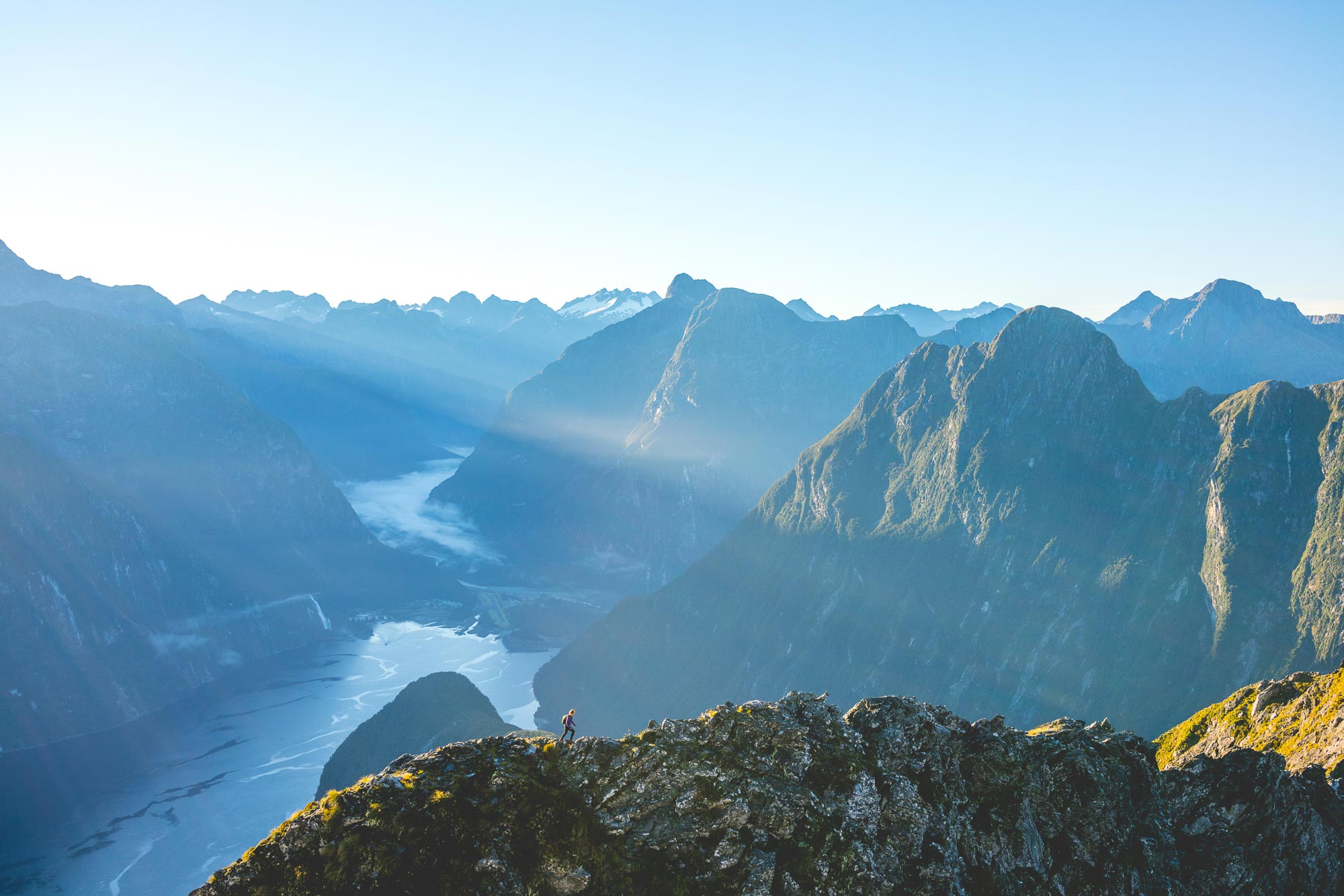 Hiking Across a knife edge on Mitre Peak in Milford Sound, NZ