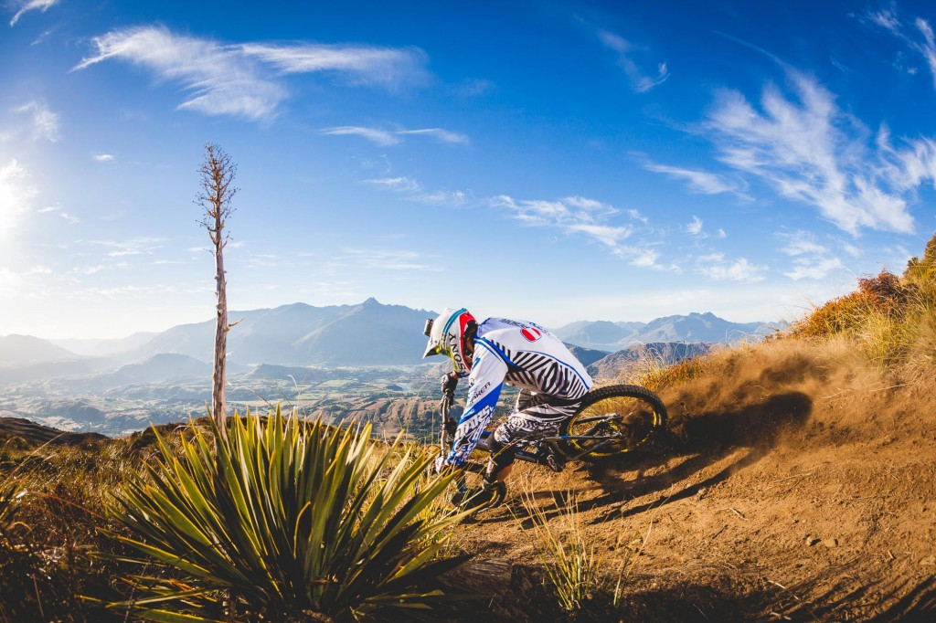 Mountain Bike rider Markus Pekoll riding down Coronet Peaks Rude Rock MTB track in Queenstown