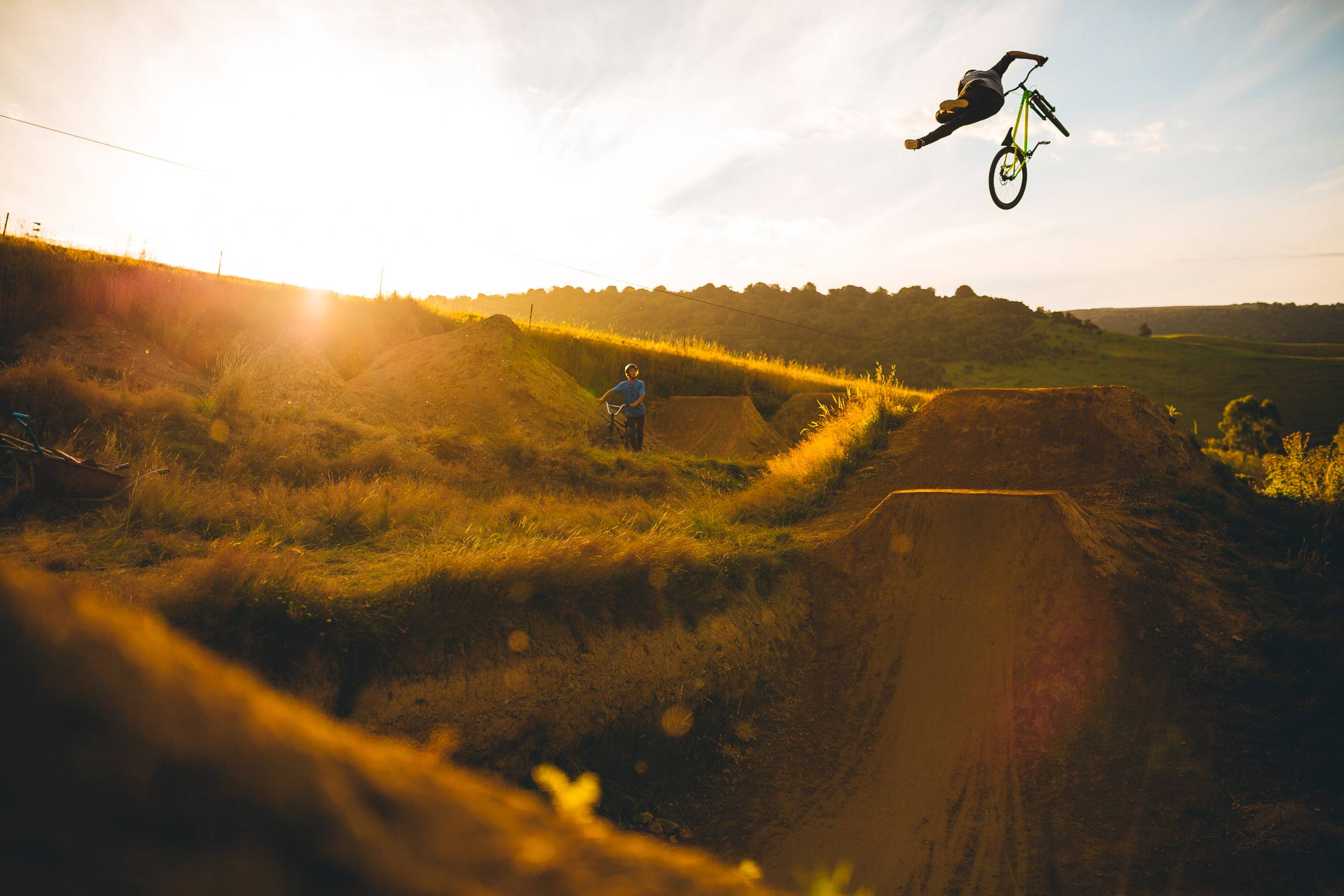 Mountain Bike rider Nick Dethridge jumping at Frew Farm at Sunset