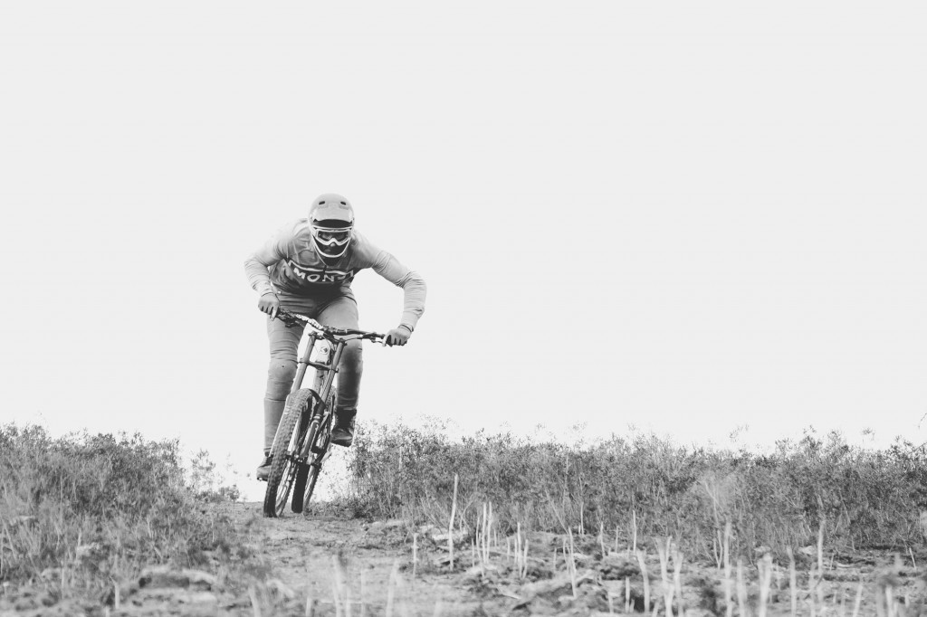 Mountain biker Conor macfarlane pedalling into bike jump