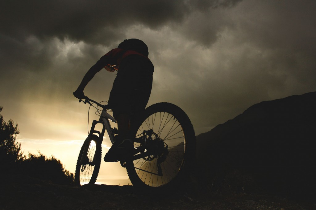 Mountain biker Matt Wragg riding in storm in Queenstown