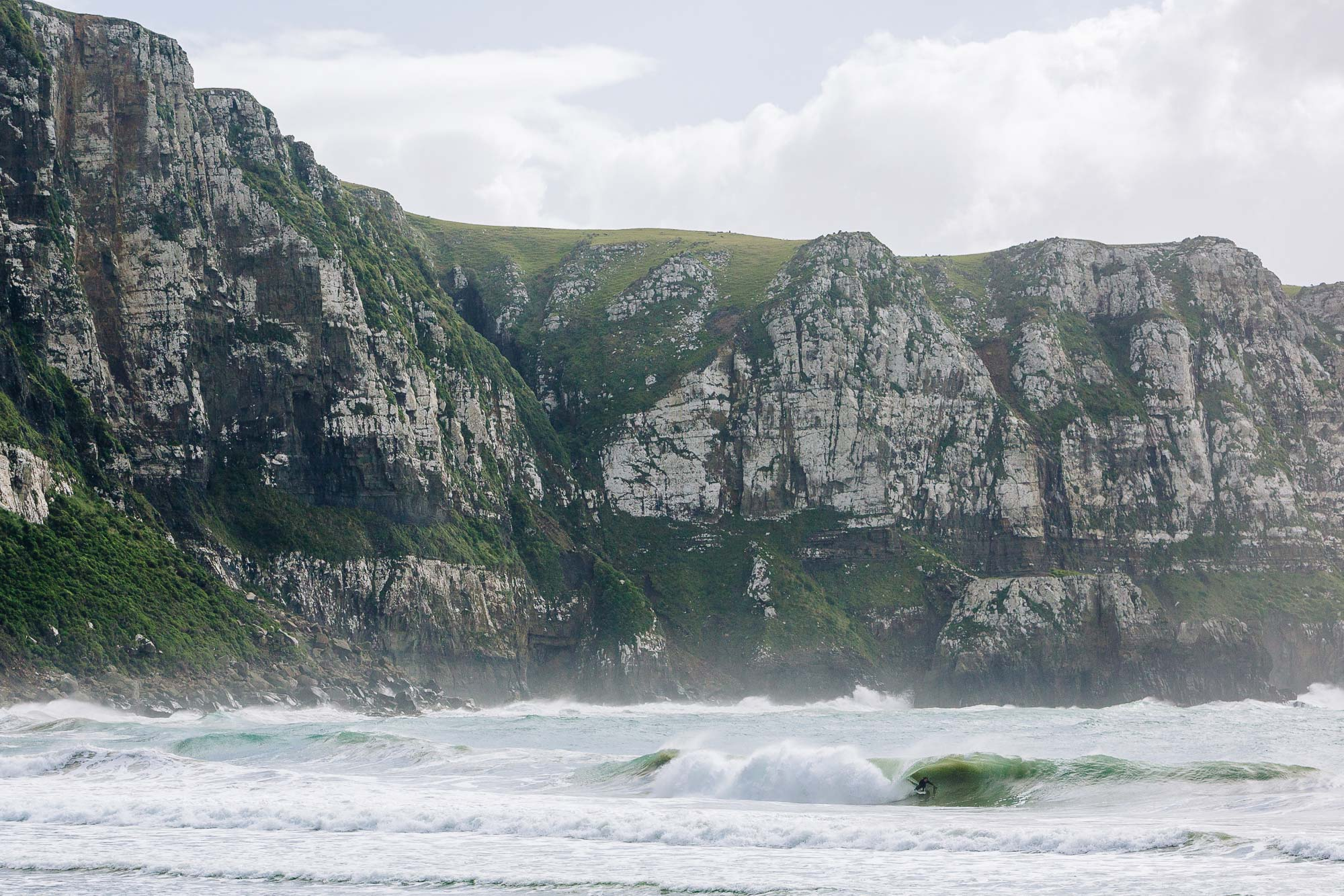 Nick Rapley surfing along New Zealands best coast line
