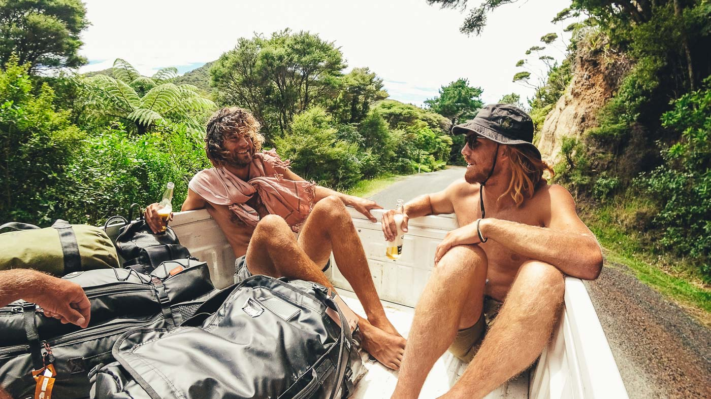 Mates drinking beer in the back of the ute driving across Great Barrier Island in New Zealand. Photo by Sony Ambassador Stefan Haworth