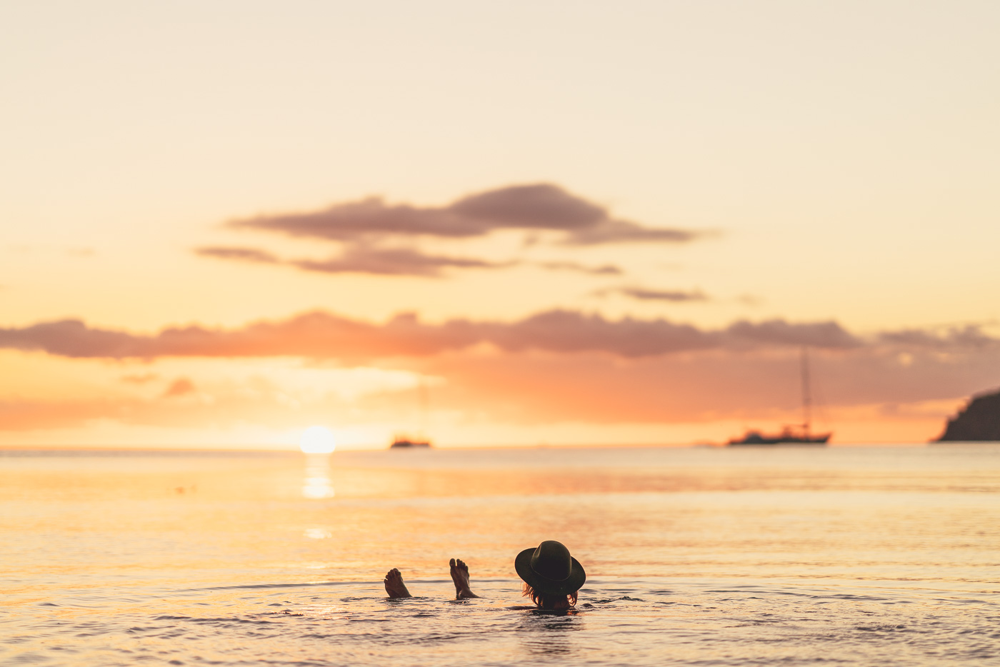 Laying in the ocean while watching sun set on the horizon on Great Barrier Island in New Zealand. Photo by Sony Ambassador Stefan Haworth