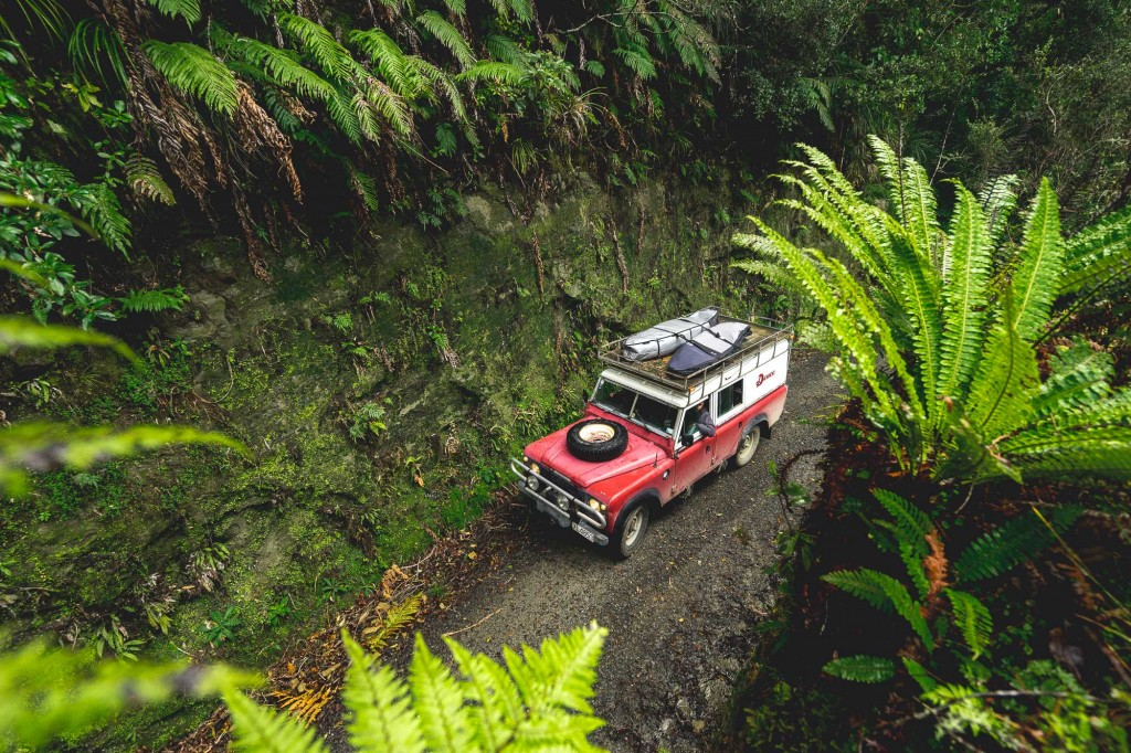 Driving the Deuce Land Rover through hidden New Zealand native forestry and tunnels