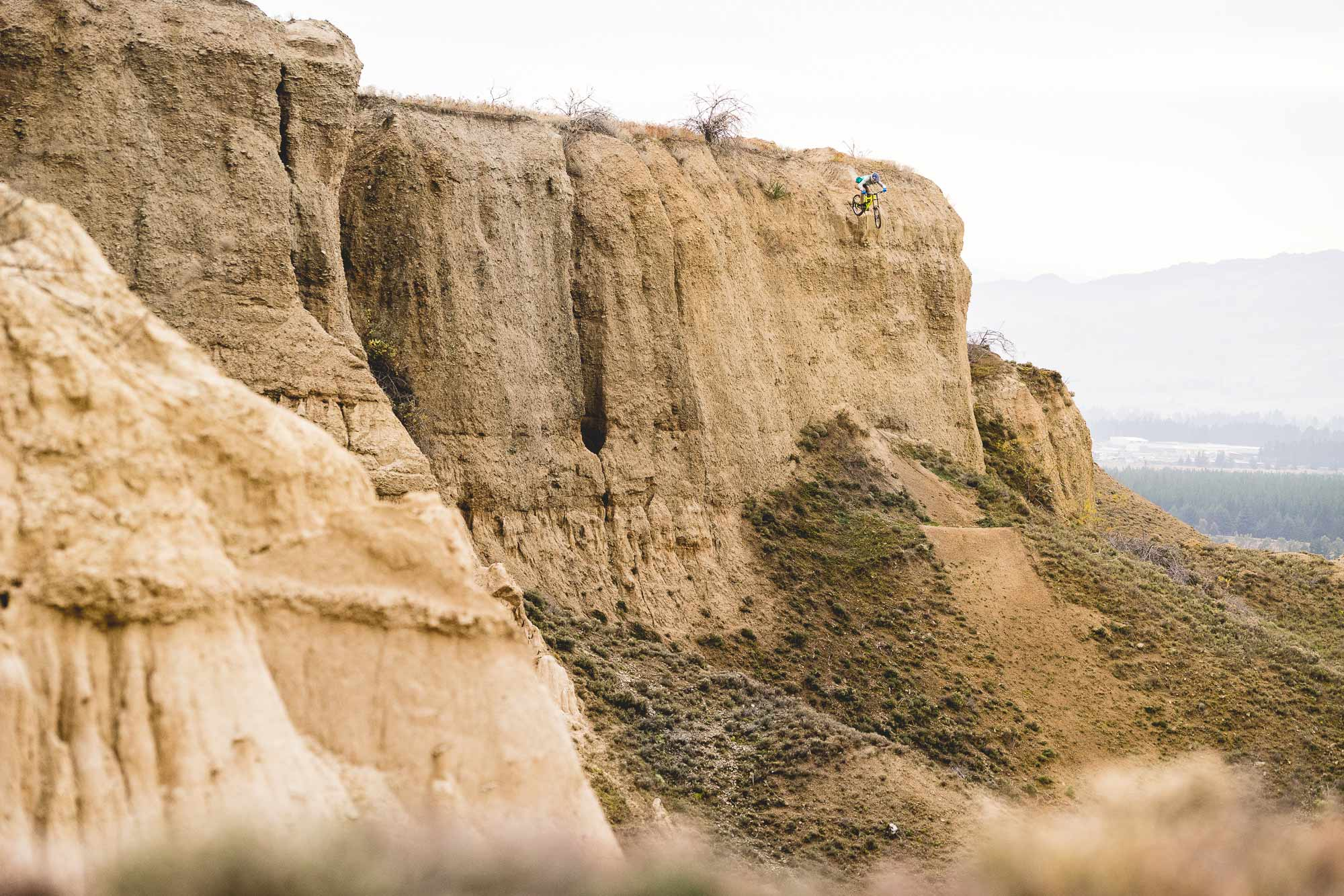 Mountain biker Conor macfarlane huge cliff drop in New Zealand