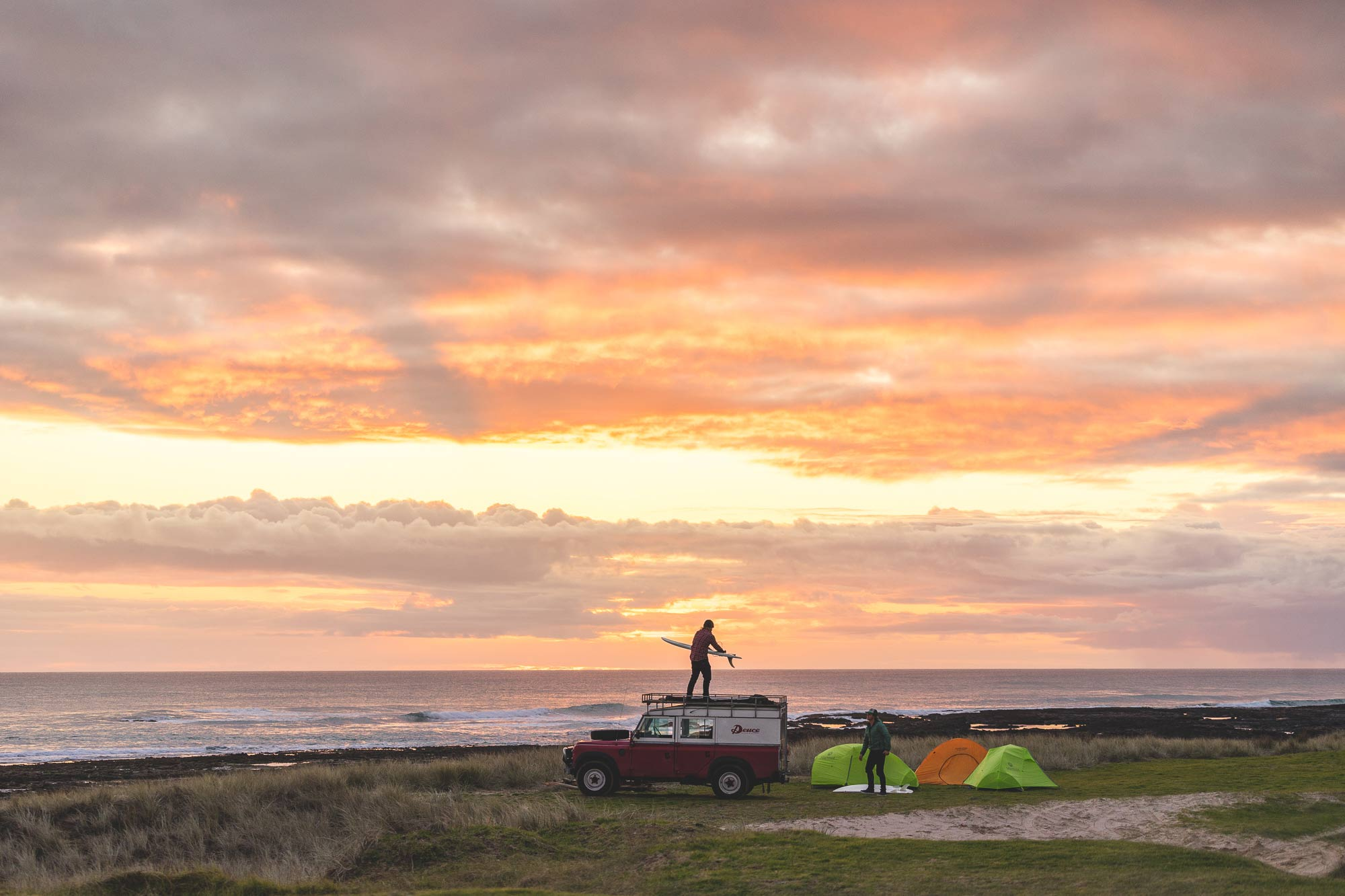 Unloading the Deuce Land Rover and setting up camp on the beach in New Zealand