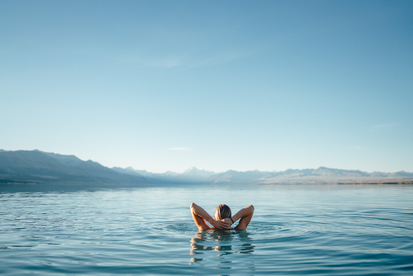 Swimming in Lake Pukaki looking towards Mount Cook.