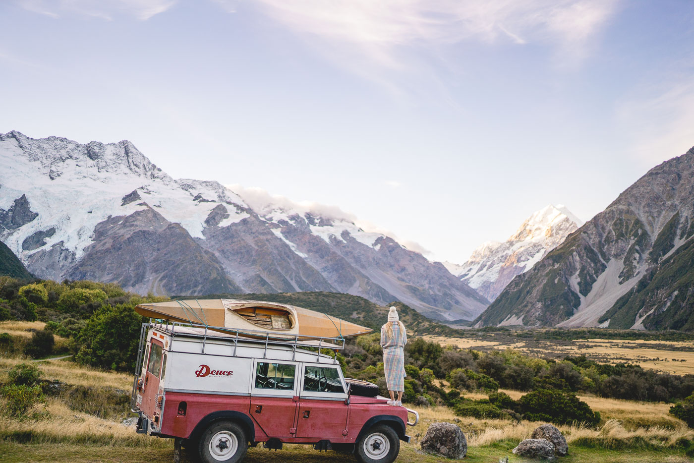 Wine and crackers on the Deuce Rover as the last evening light hits the top of Mount Cook.