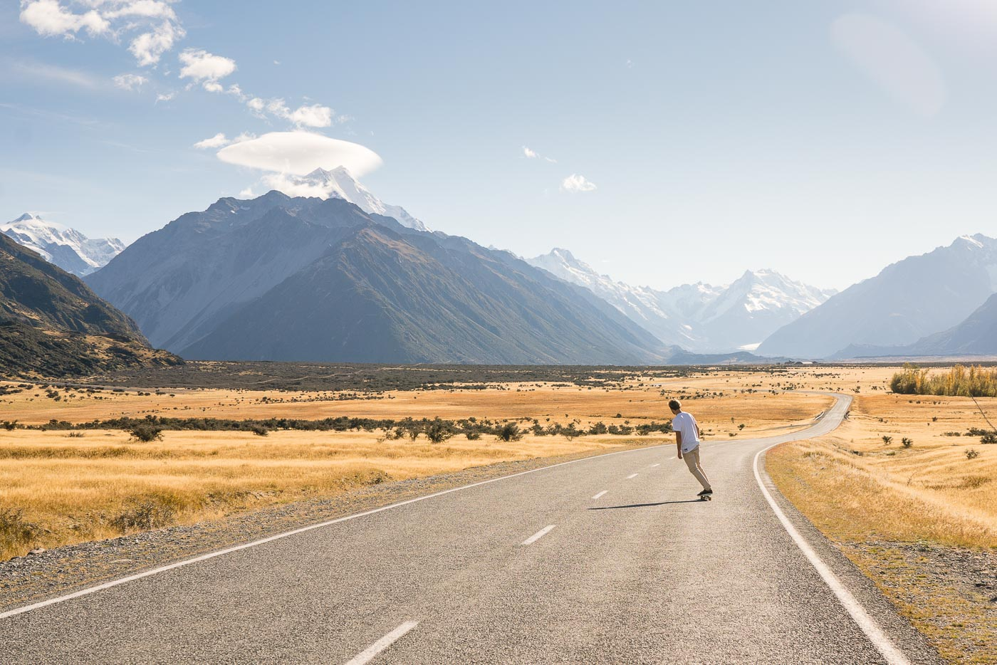 Stefan Haworth skating down the road to Mount Cook National Park.