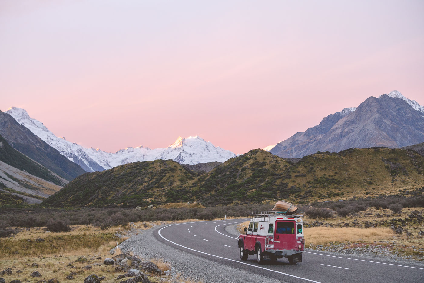 Deuce Rover driving at sunrise through Mount Cook National Park