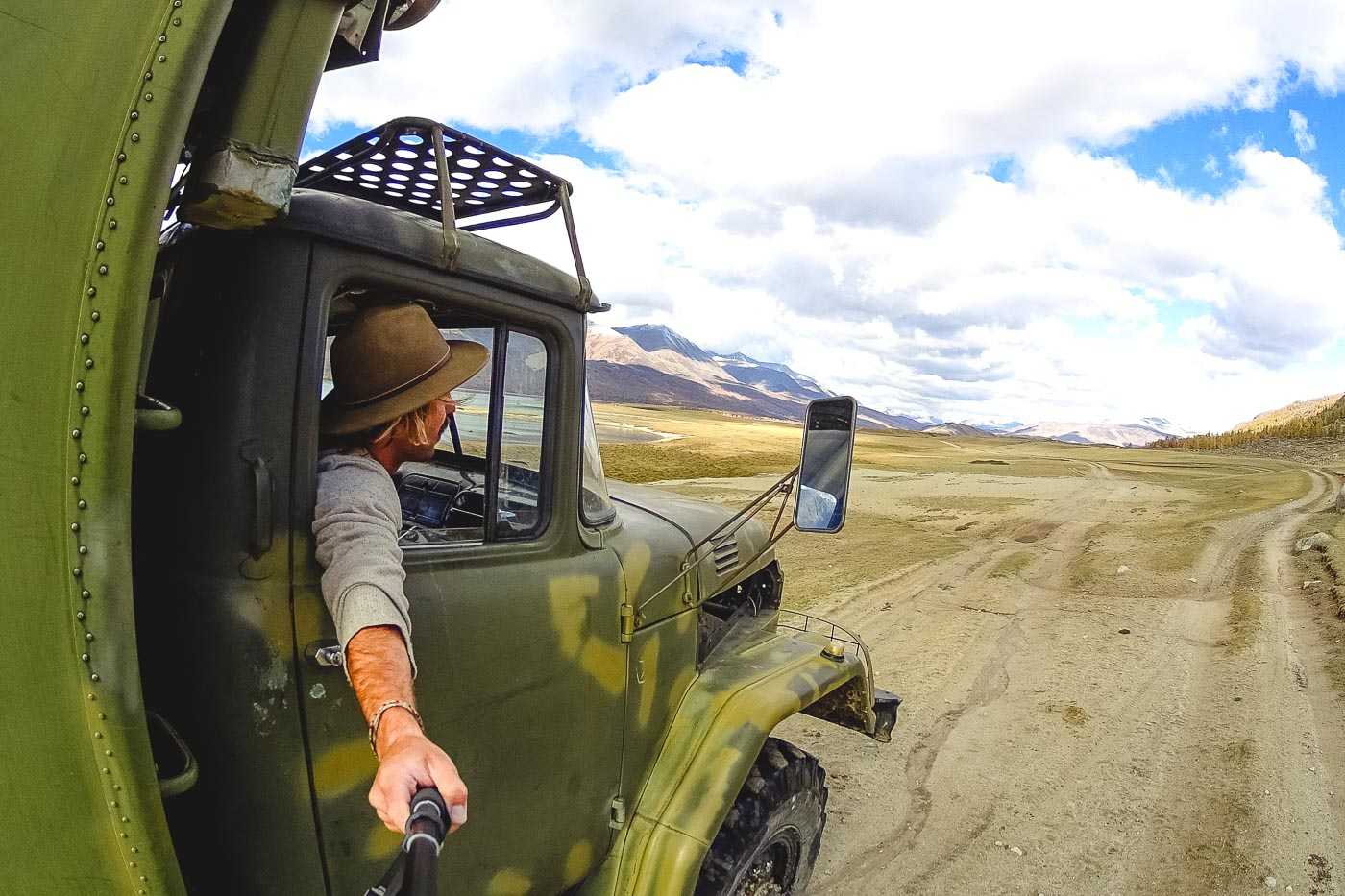 Stefan Haworth riding in an old Military truck through the Alta Mountains of Mongolia