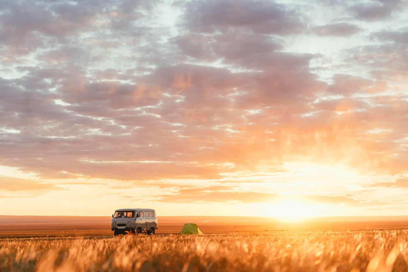 sunrise over the van and tent in Mongolia