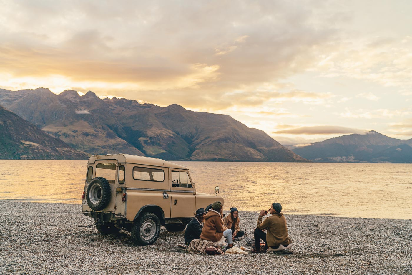 Enjoying beers next to a land rover at sunset in Queenstown, New Zealand