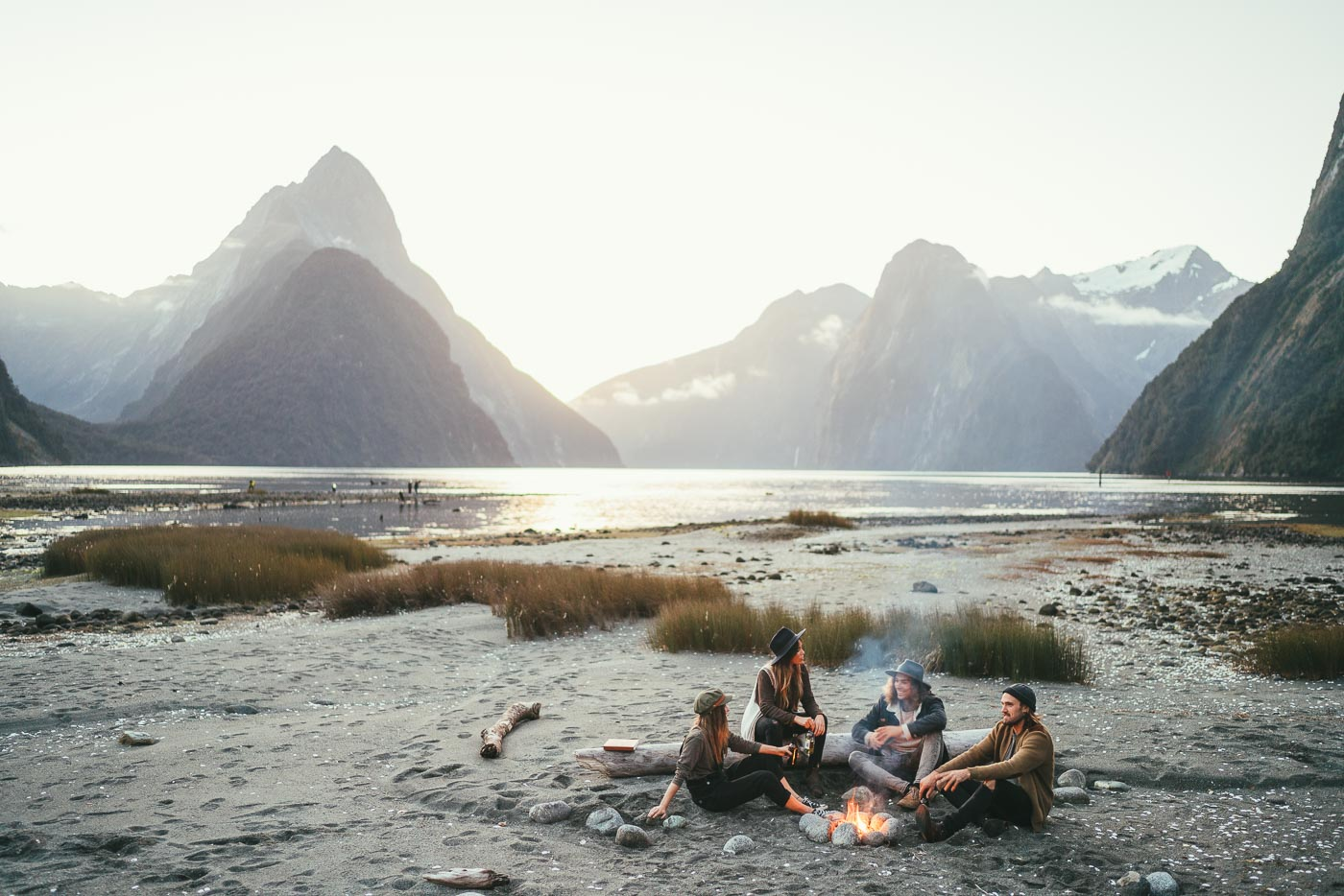 Friends having a campfire at Milford Sound, New Zealand