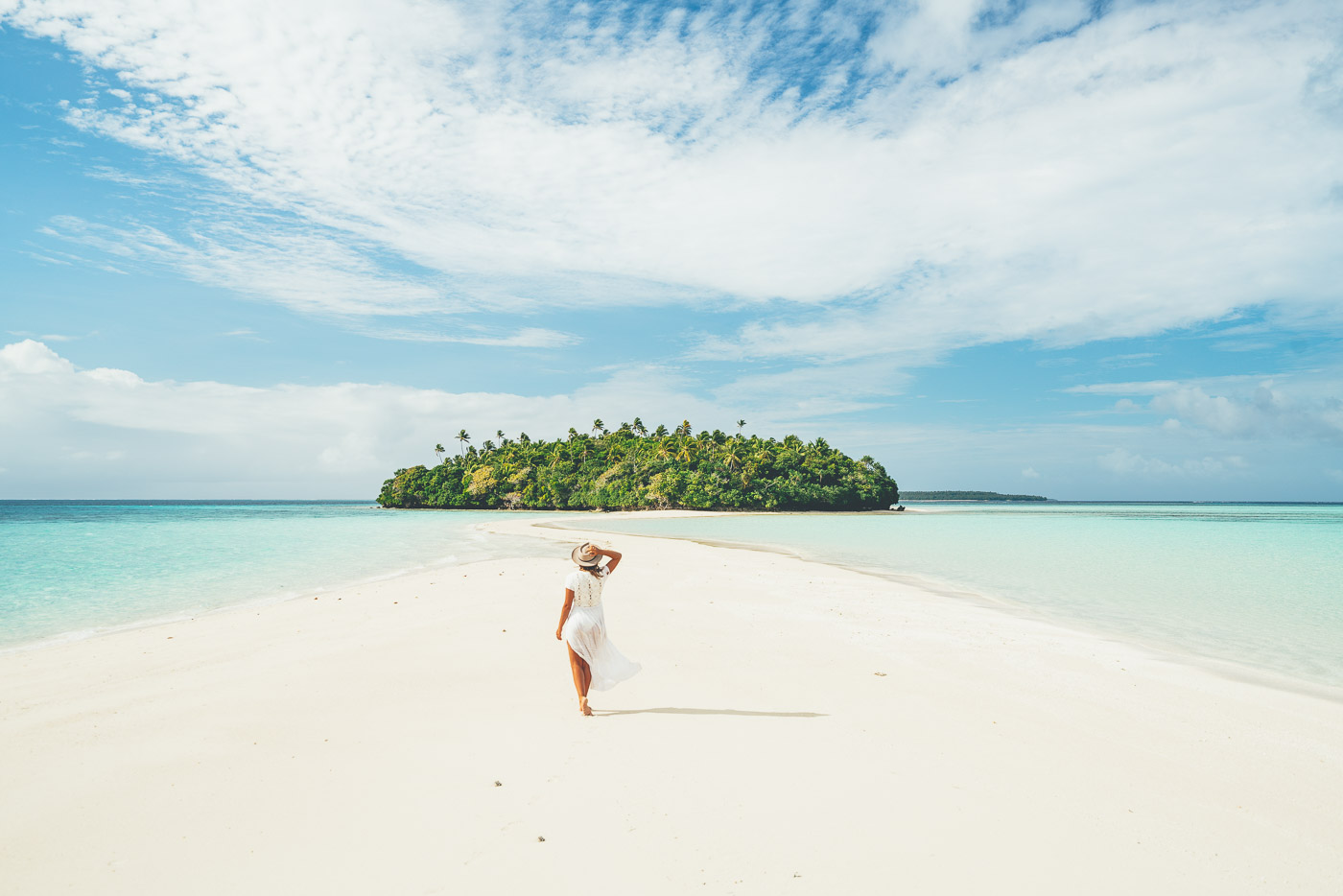 girl walking on white sand beaches of Vava'u Tonga