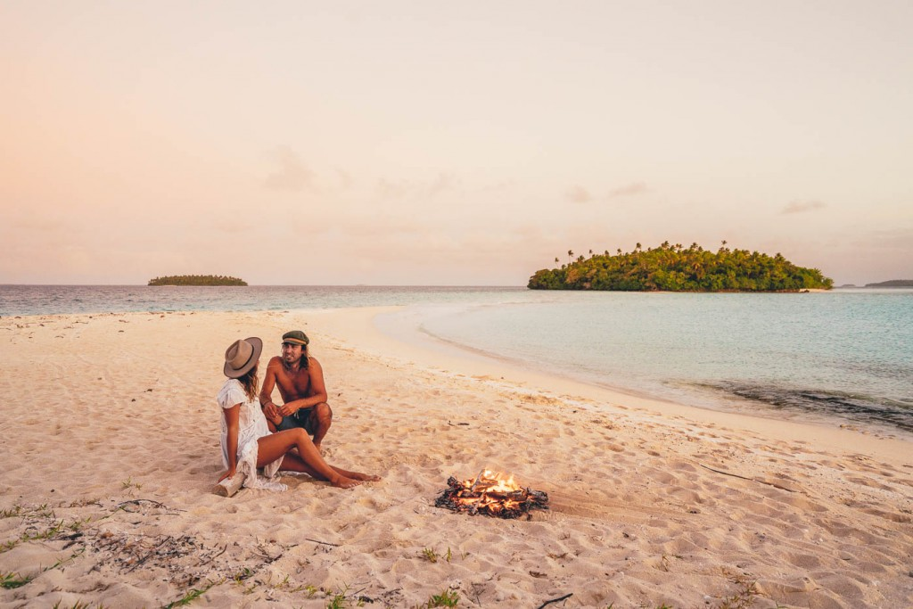 Photographer Stefan Haworth and Mel enjoying a campfire in Vava'u Tonga