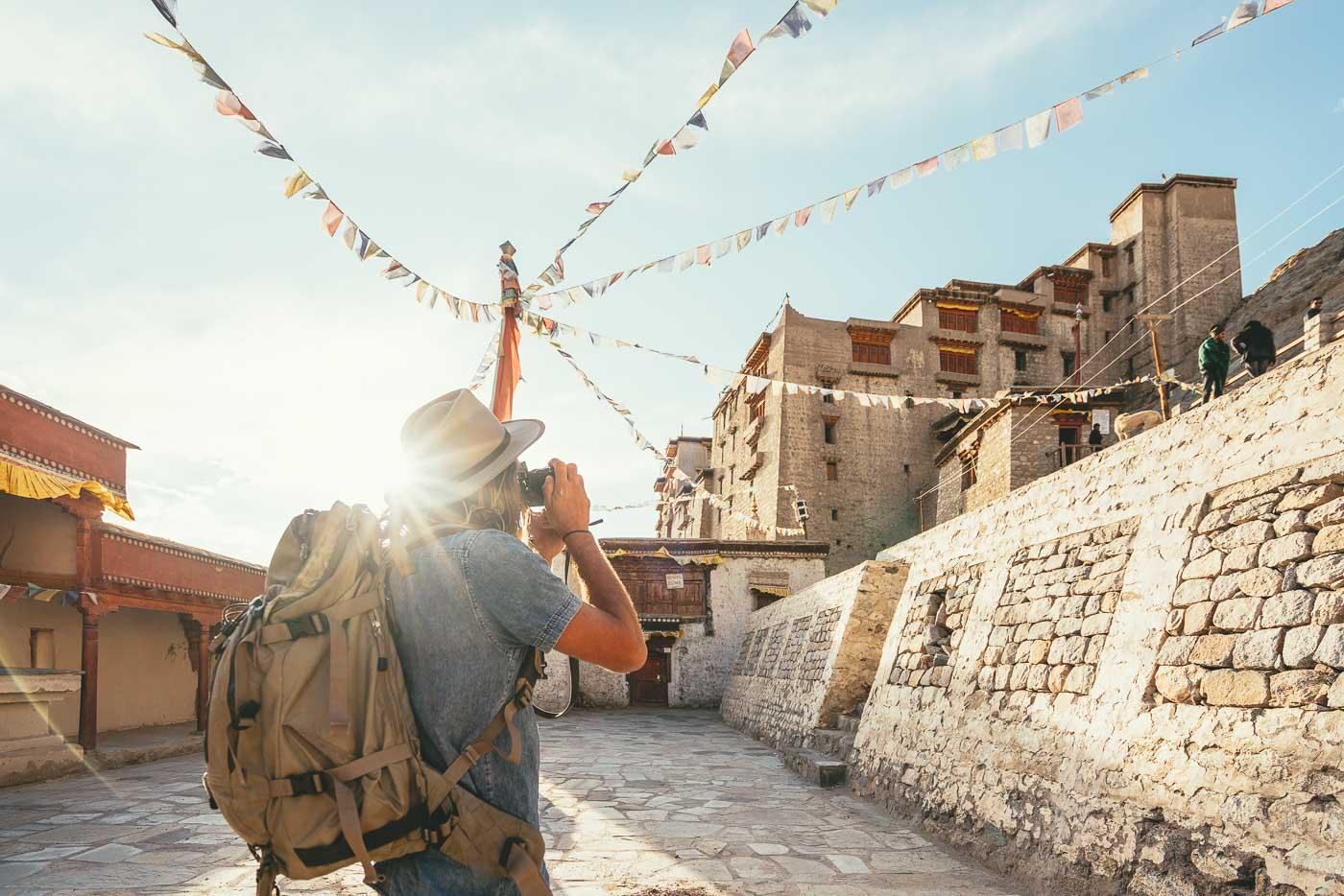 Photographer Stefan Haworth taking photos of Monastery in Ladakh India