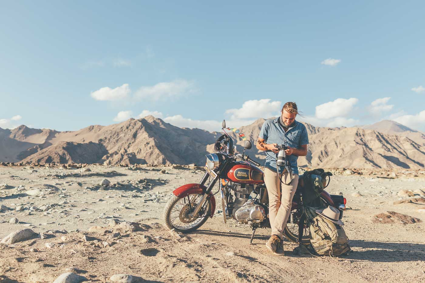 Photographer Stefan Haworth riding a Royal Enfield Motorbike through the Indian Himalayas