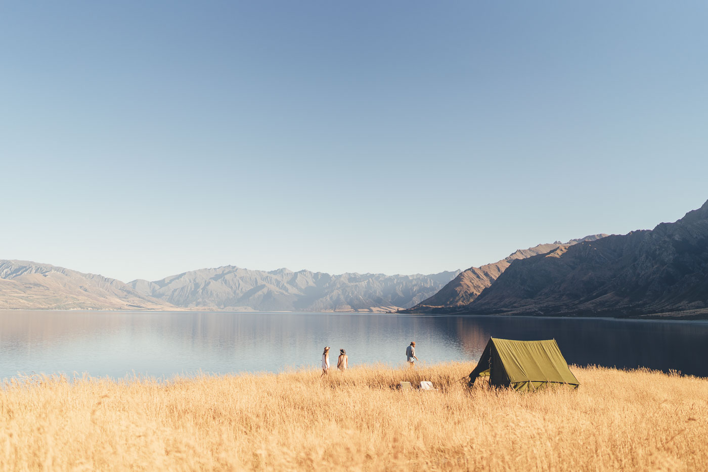Camping on the edge of Lake Hawea in New Zealand on the Will and Bear Road trip