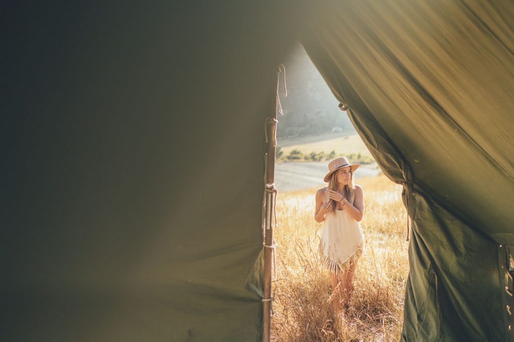Lauren Willliamson in long grass in New Zealand on the Will and Bear Road trip