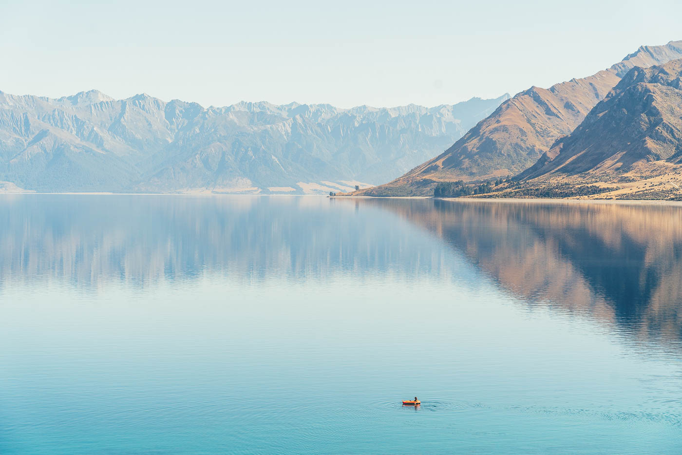 Floating across Lake Hawea in New Zealand on the Will and Bear Road trip