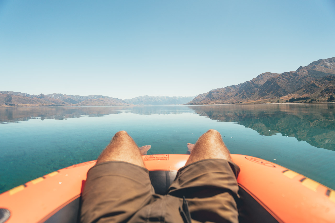 POV Floating across Lake Hawea in New Zealand on the Will and Bear Road trip