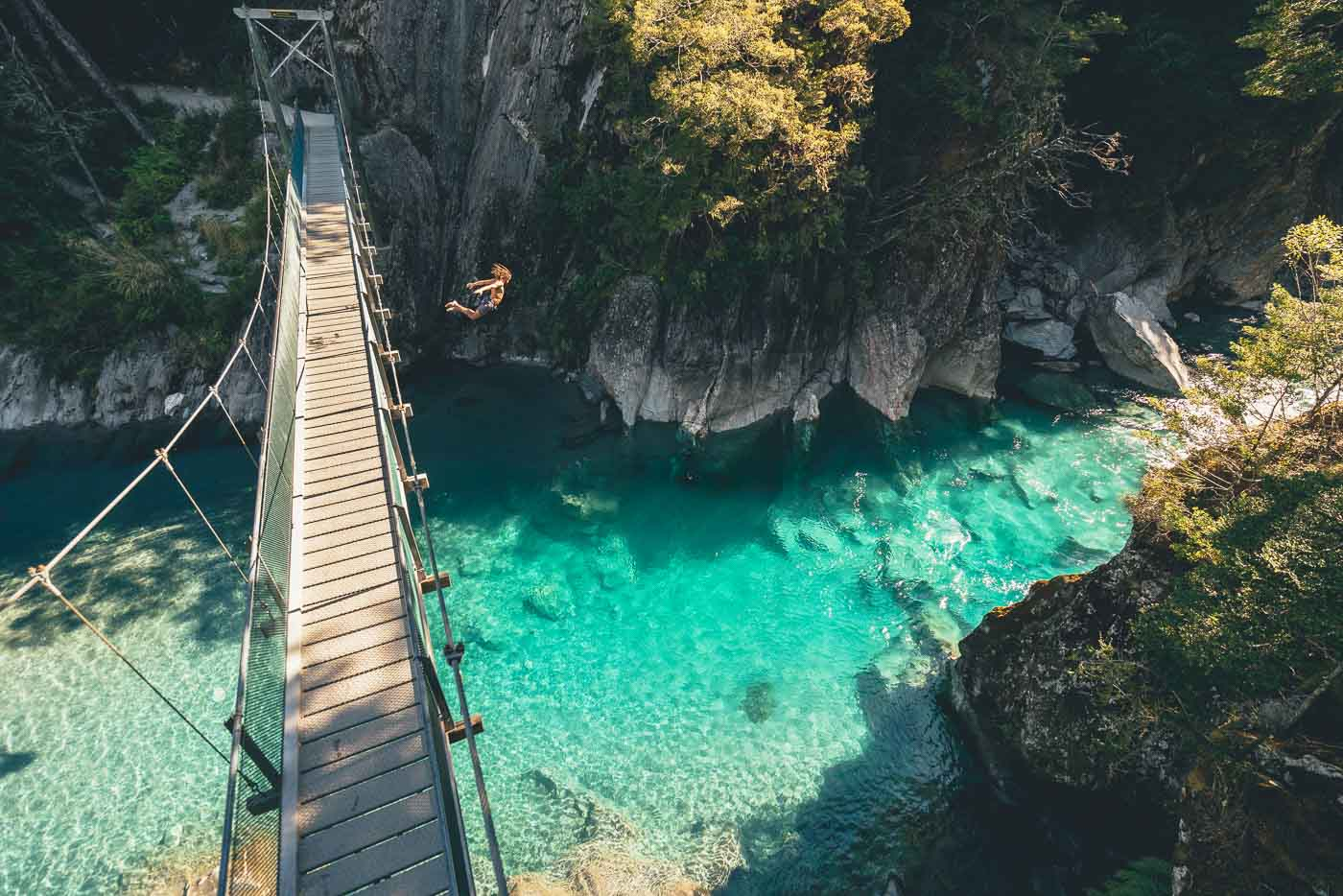 Alexander Knorr jumping off the Blue pool bridge in New Zealand on the Will and Bear Road trip
