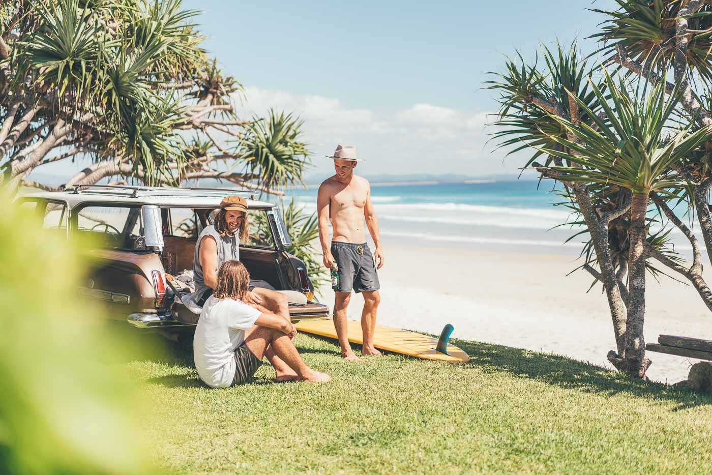 Hanging at the back of a vintage car after a surf at Byron Bay