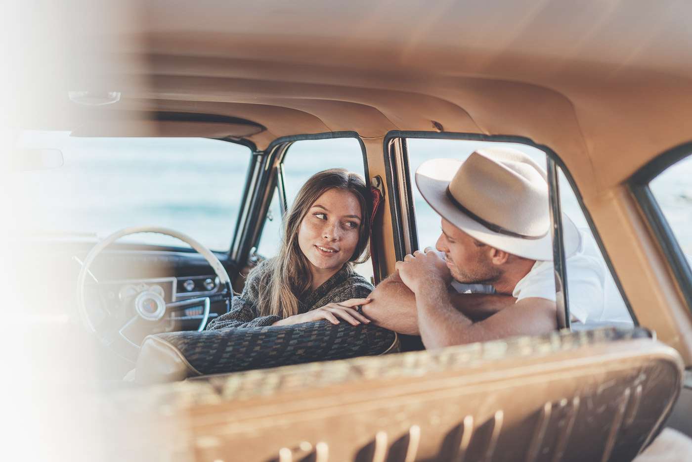 Couple chatting in the vintage car