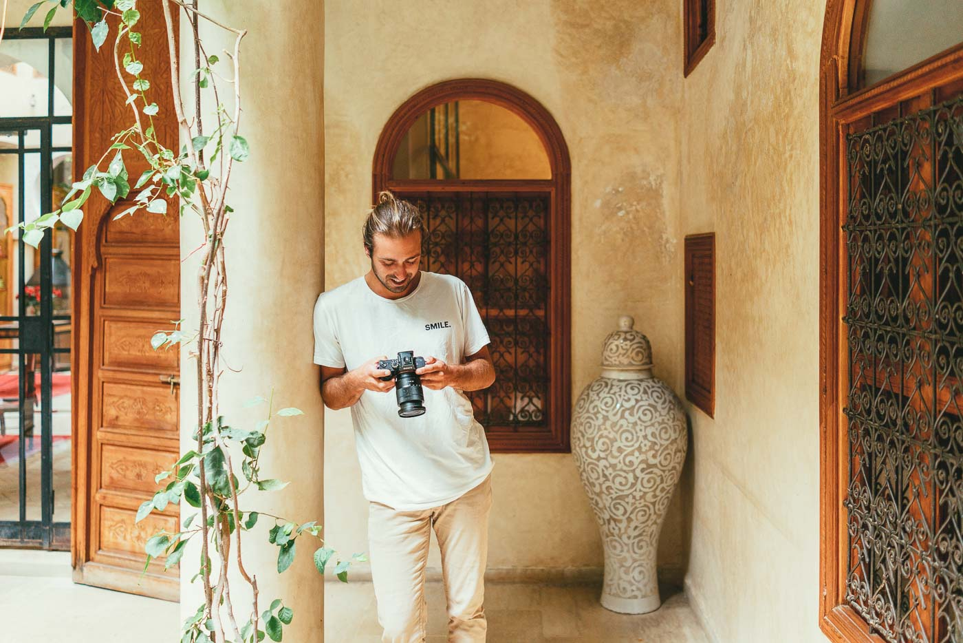 Photographer Stefan Haworth reviewing photos in Morocco